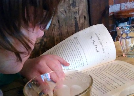 child reading kids chapter books in cafe