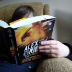 Boy reads Scorpio Rising Alex Rider Book 9 book middle grade fiction children's fiction action spy adventure