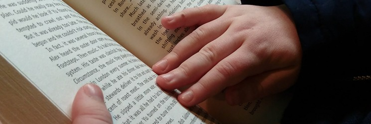 Reading-hands-holding-book-About-Reading-Inspiration-a-book-blog-for-kids-and-parents