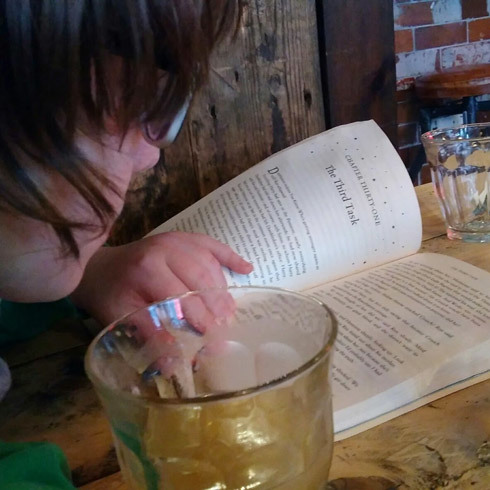 child-reading-cafe-books-anywhere-importance-of-reading-to-children-photo-by-reading-inspiration