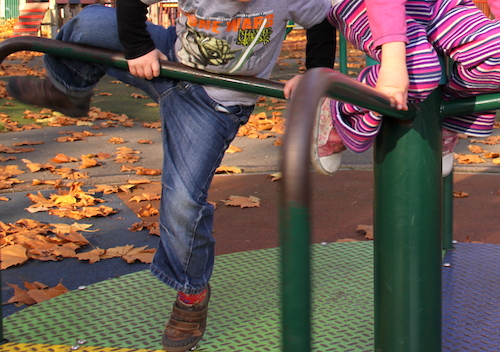 children climbing in playground - image for activity tracker kids article