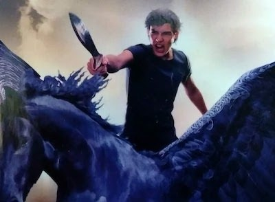 Detail from The Titan's Curse (Percy Jackson 3rd book) cover art - boy in a heroic pose on a winged horse